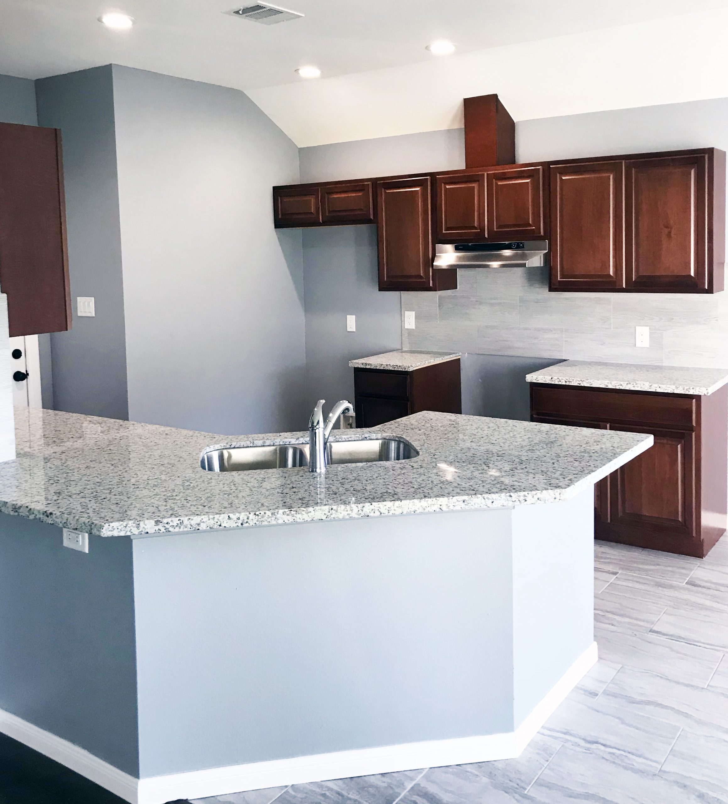 A kitchen with newly remodeled Countertops, Cabinets and Backsplash